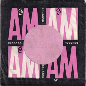 A&M Records Canadian Pink White And Black Print Company Sleeve